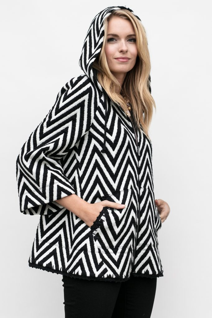 zipped up with hood up view of the chevron knit hoodie, the Lucy