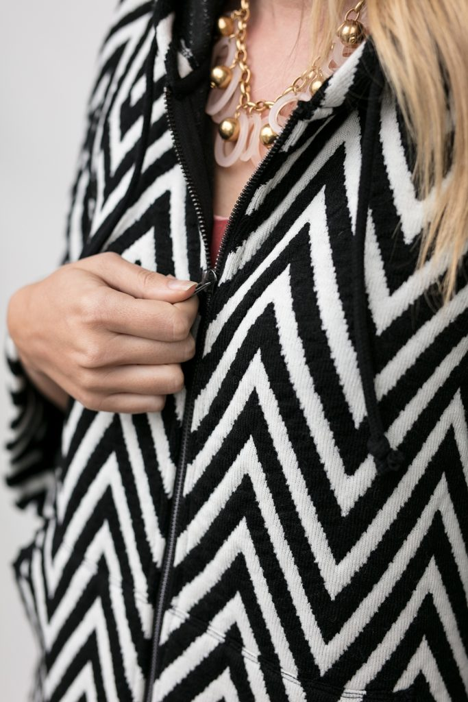 view of zipper on the chevron knit hoodie, the Lucy