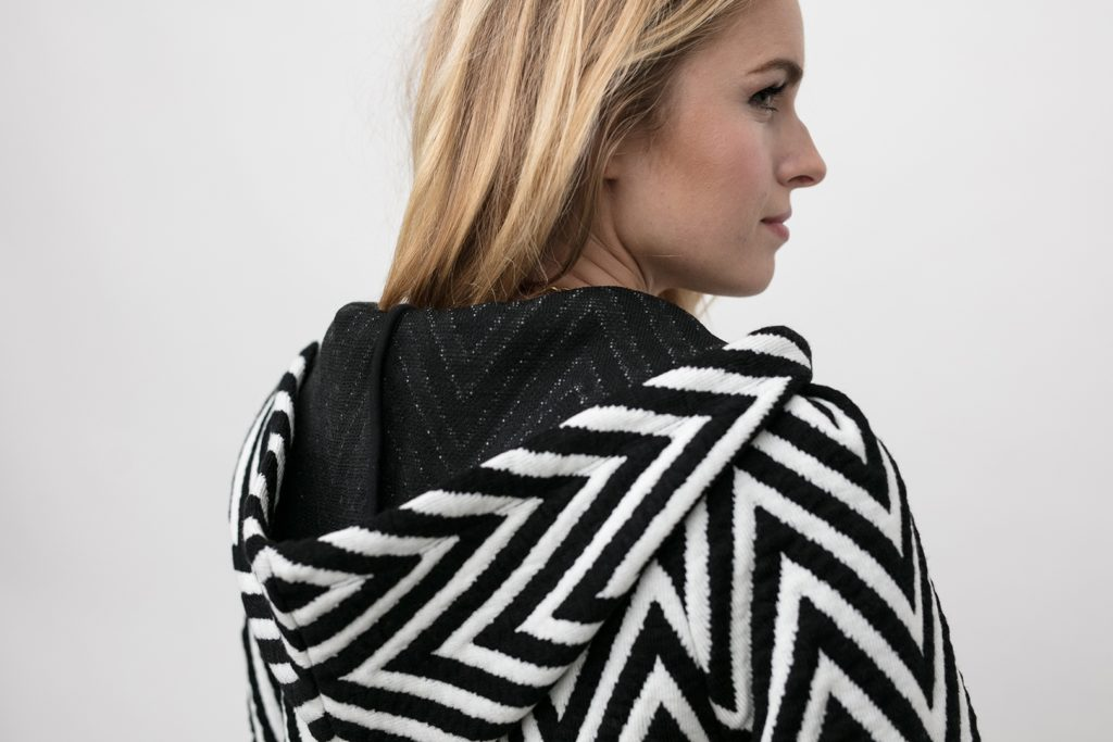up close inside view of the hood on the chevron knit hoodie, the Lucy