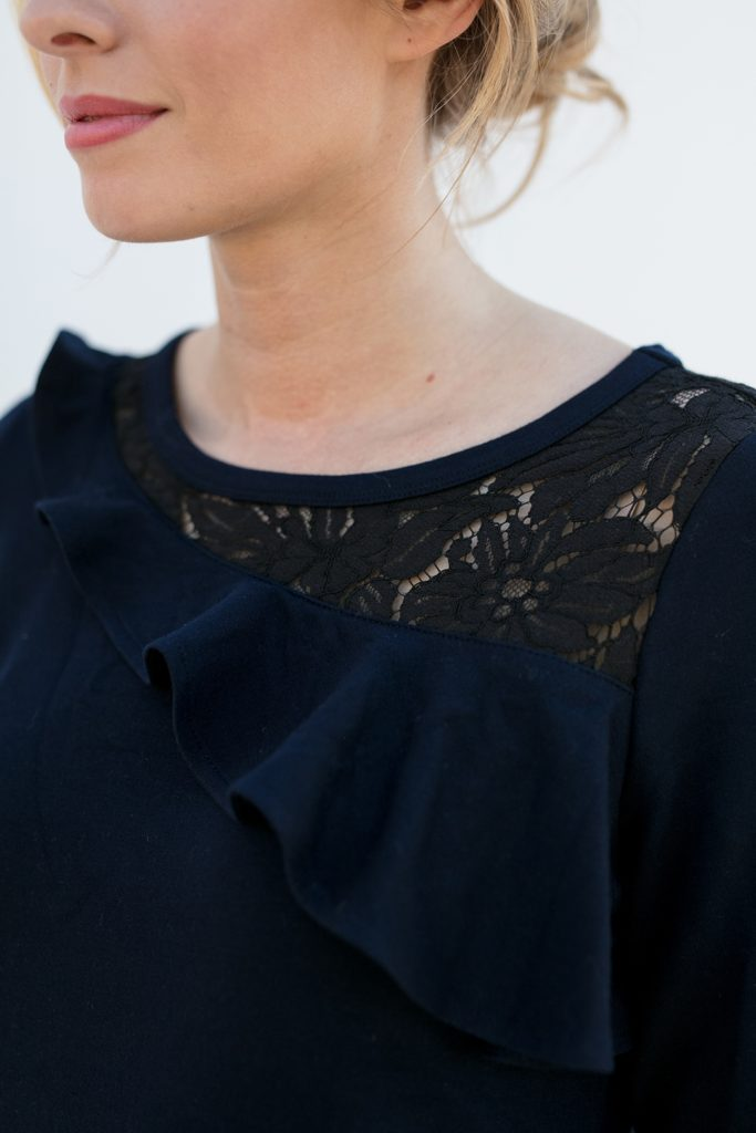 up close view of ruffle on a classy popover shirt, the Maggie in Ink