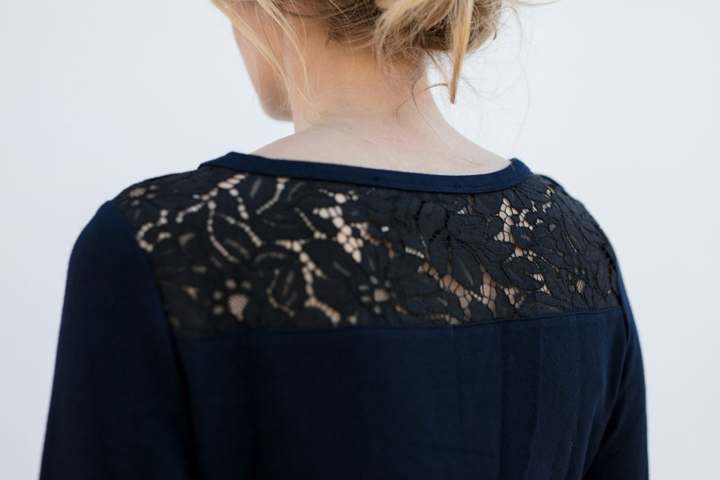 up close view of black lace shoulders on a classy popover shirt, the Maggie in Ink